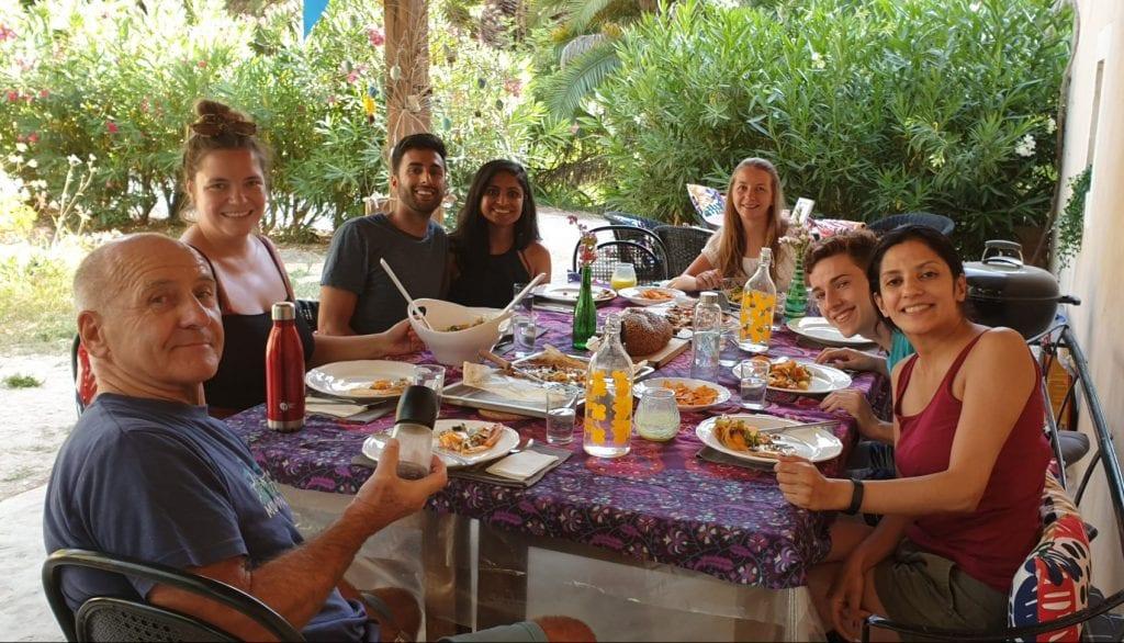 People enjoying communal dining
